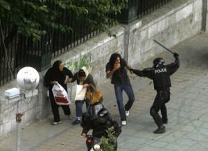 Tehran Police attack civilian