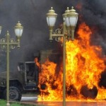 A Kyrgyz riot police vehicle burns in the capital of Bishkek on April 7th.