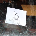 A protesting calling card left in a shattered window in downtown Toronto