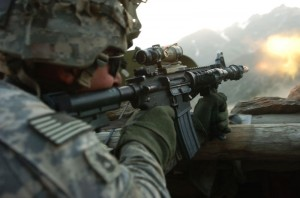 A soldier fires his weapon during Operation Mountain Fire on July 12, 2009.