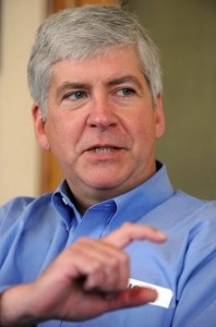 Governor Snyder has presided over very conservative policies in his first half year in office, which have stripped money from business tax incentives, schools, and soon - welfare recipients.